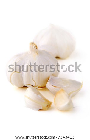 Bulbs and cloves of garlic isolated on white background