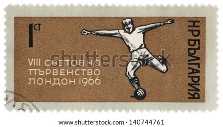 BULGARIA - CIRCA 1966: A stamp printed in Bulgaria shows football player kicks the ball, dedicated to the World Cup in London in 1966, circa 1966 - stock photo