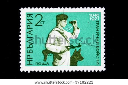 BULGARIA  - CIRCA 1971: A stamp printed in Bulgaria shows  frontier guard with a dog, circa 1971 - stock photo