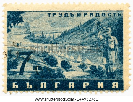 "BULGARIA- CIRCA 1942: A stamp printed in Bulgaria shows tent camp, bugler and the inscription ""Work and joy"", circa 1942"