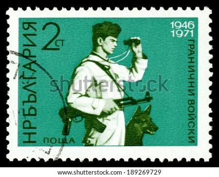 BULGARIA - CIRCA 1971: A Stamp printed in the Bulgaria  shows  Frontier Guard and German Shepherd, circa 1971  - stock photo