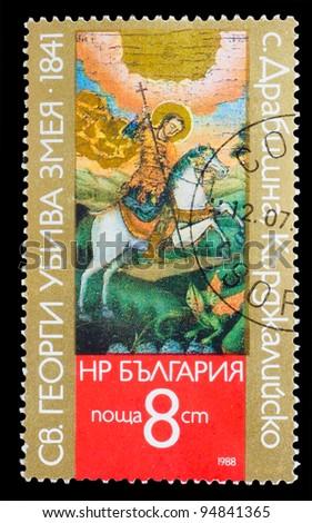 "BULGARIA - CIRCA 1988: stamp printed by Bulgaria, shows Drabishna Kardjali ""George kills the dragon"", circa 1988 - stock photo"