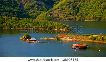 bulgarian amazing nature- floating houses in the lake - stock photo