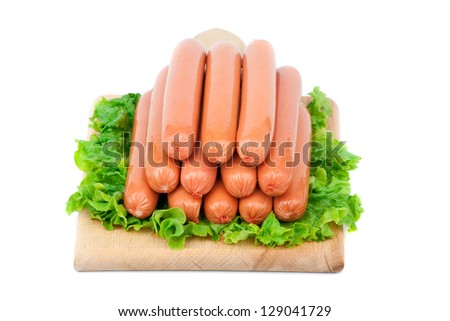 Bulgarian chicken Sausages arranged on cutting board with lettuce