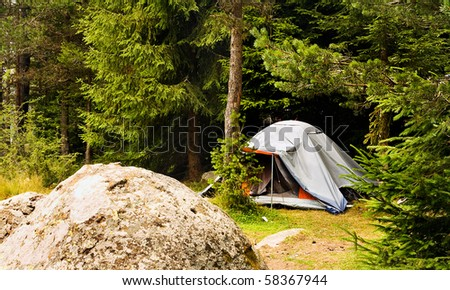 bulgarian forest landscape with tent - stock photo