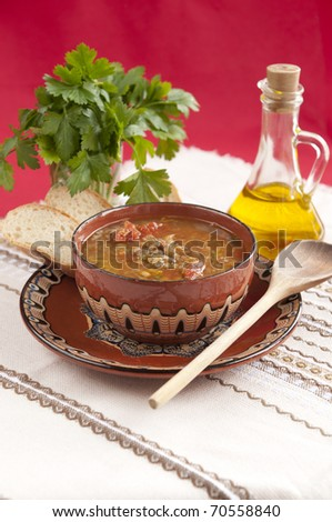 Bulgarian lentil soup with tomatoes, onion, garlic - vegetarian - stock photo