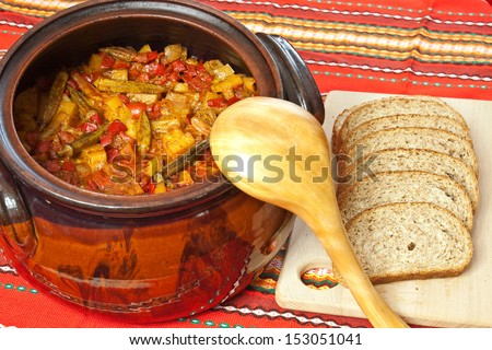 Bulgarian national dish - vegetable stew prepared and served in a ceramic pot - stock photo