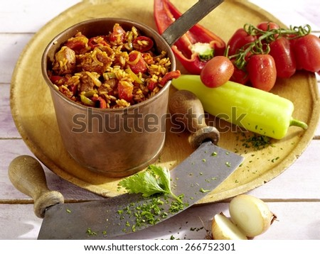 Bulgarian Rice and Pork on wooden board - stock photo