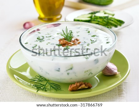 Bulgarian summer soup with cucumbers, dill and walnut - stock photo