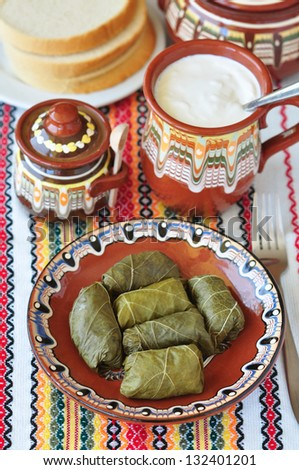 Bulgarian traditional meal - dolma with plain yogurt - stock photo