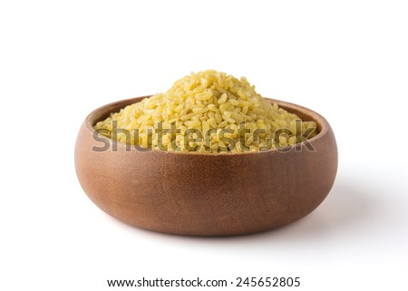 Bulgur in a wooden bowl. With Clipping Path. - stock photo