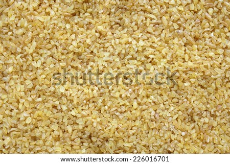 Bulgur wheat as an abstract background texture - stock photo