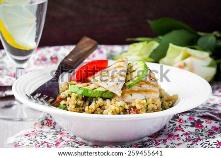 Bulgur with vegetables and grilled chicken, healthy, diet tasty summer dish - stock photo