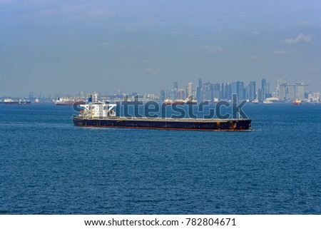 Bulk carrier cargo ship underway along Singapore coastline.