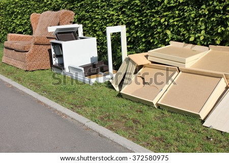 bulk garbage for collection at roadside - stock photo