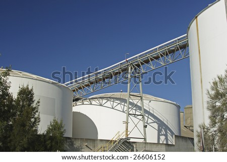 Bulk storage tanks and a loading ramp.