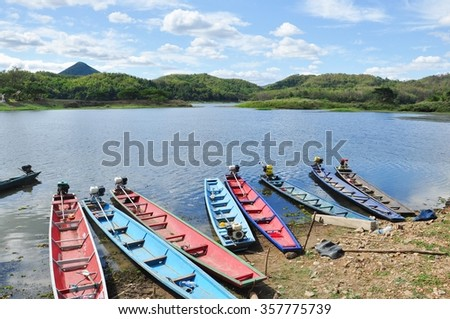 Bull Creek Reservoir, Loei province Thailand. The reservoir's dam has a capacity of 26 million cubic meters. The atmosphere is surrounded by the beautiful scenery of bamboo forest. - stock photo