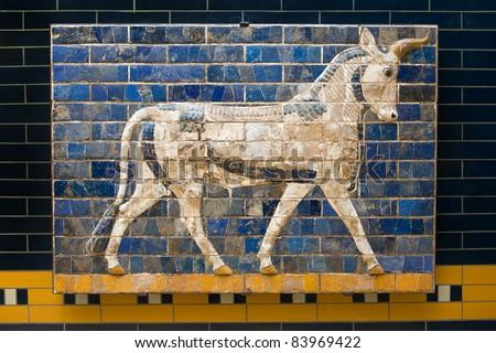 Bull on Babylonian mosaic, fragment of the Ishtar Gate in Istanbul, Turkey - stock photo