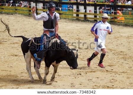 Bull Rider & Rodeo Clown - stock photo