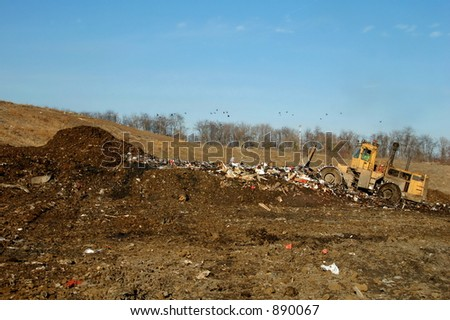 bulldozer at garbage dump