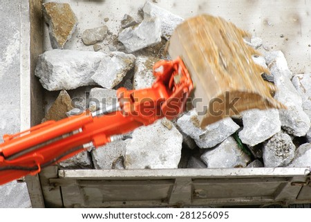 bulldozer excavator machine industry picks up debris on city street - stock photo