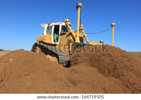 bulldozer guided in action - stock photo