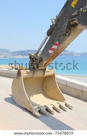 Bulldozer in a beach - stock photo