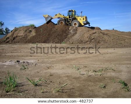 bulldozer in a gravel pit - stock photo