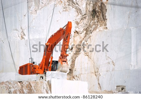 bulldozer in carrara's quarry - stock photo