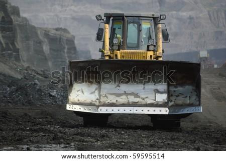bulldozer in coal mine - stock photo