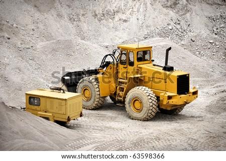 Bulldozer in open-pit cooper mine - stock photo
