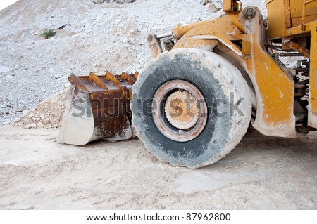 bulldozer in quarry - stock photo