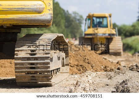 Bulldozer machine during construction road works