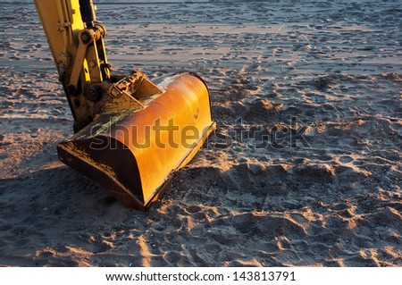 bulldozer on beach for cleaning sand - stock photo