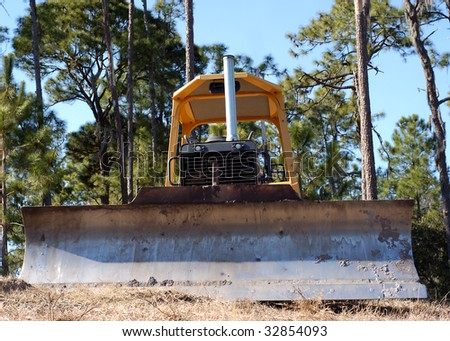 bulldozer on hill - stock photo