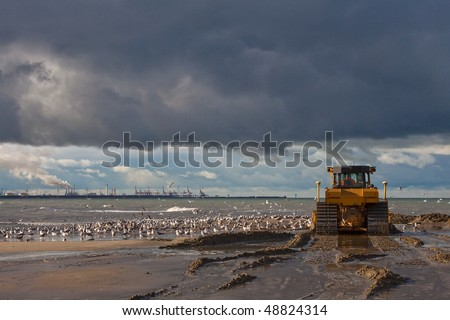 Bulldozer on the Beach - stock photo
