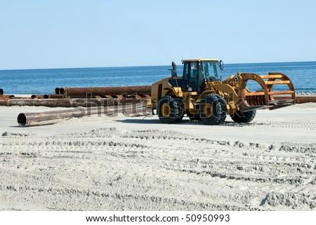 Bulldozer pulling Pipe - stock photo