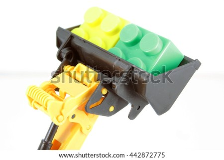 Bulldozer toy bucket and some cubes. - stock photo