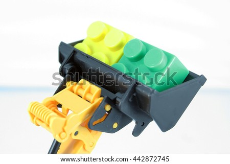 Bulldozer toy bucket with cubes in. - stock photo