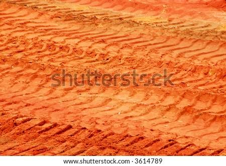 Bulldozer Tracks in Clay Dirt - stock photo