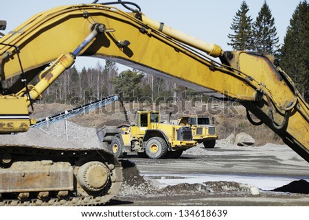 bulldozer, trucks and gravel pits