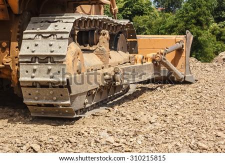 bulldozer working in mining industry - stock photo