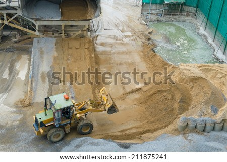 bulldozer working in the construction site - stock photo