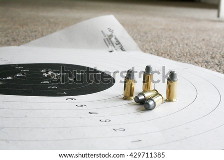 Bullet and Target - stock photo