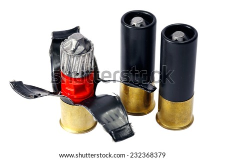 Bullet cartridges for the shotgun in disassembled form isolated on white background  - stock photo