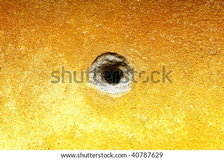Bullet hole in a wall - stock photo