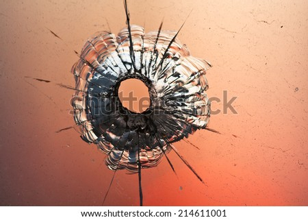 Bullet hole in the glass - stock photo