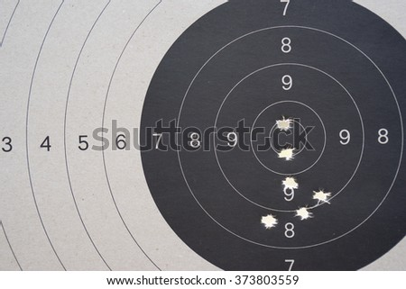 Bullet hole on black and white target.