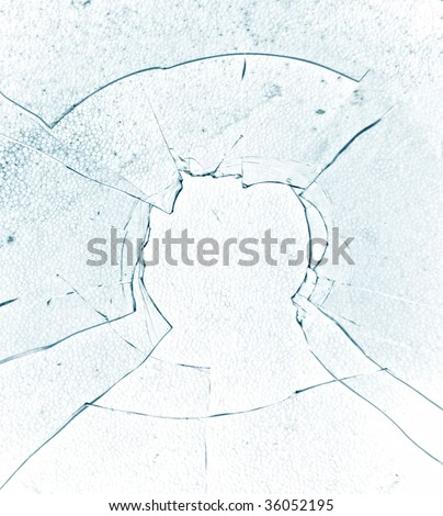 Bullet hole - shattered glass - stock photo