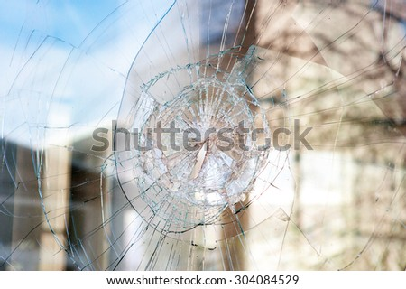 bullet holes in the window of the shop. - stock photo